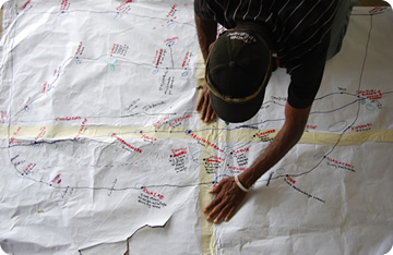 imge of man looking at a hand-drawn map
